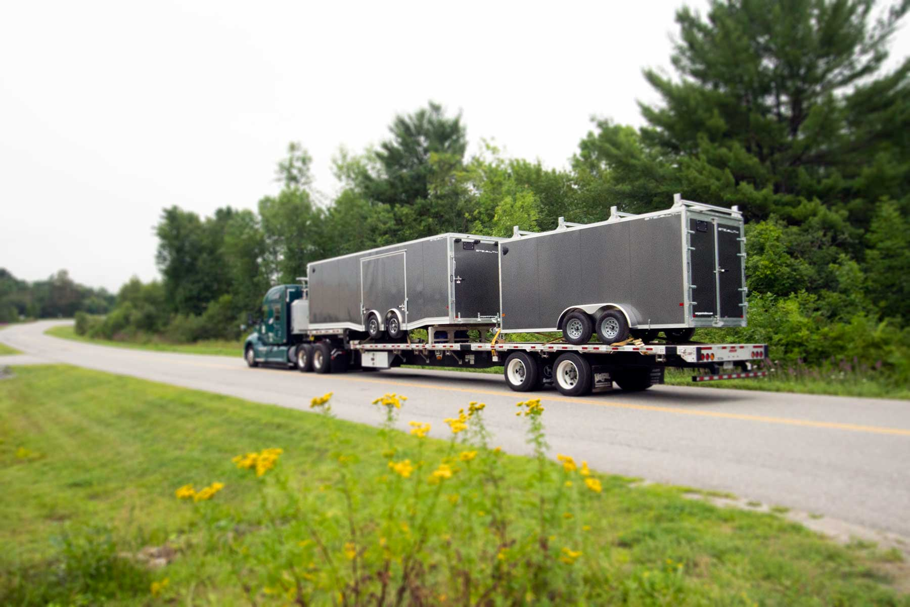 alcom_delivery_truck_loaded_with_trailers